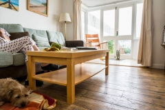 Wooden floors in the sitting room at Beach Cottage
