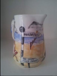 Handpainted ceramic milk jug